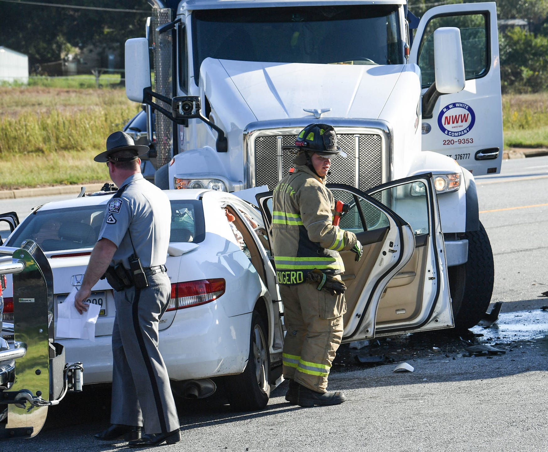Photos: Two injured in Anderson after dump truck-sedan wreck