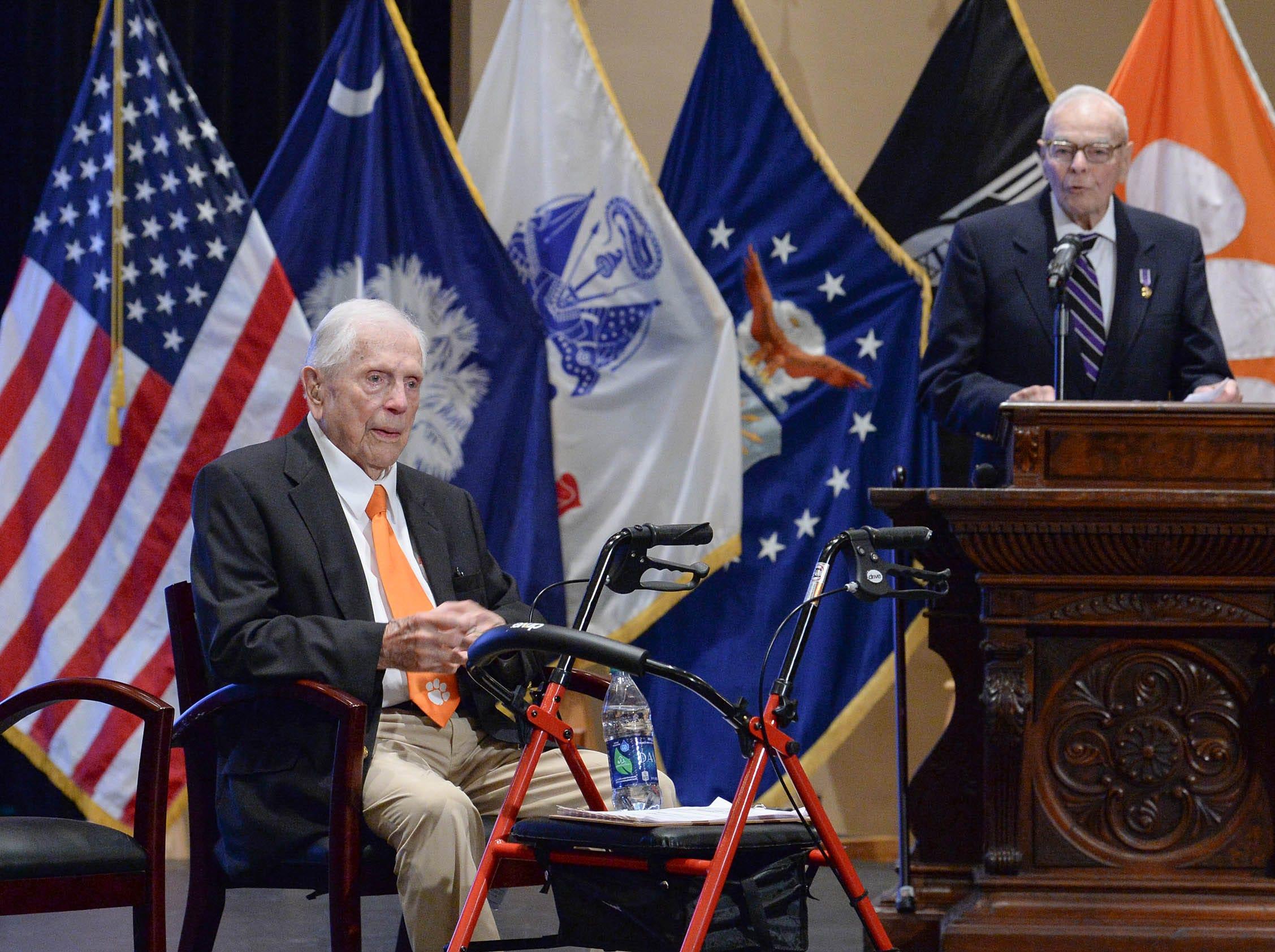 Living Prisoners of War, Col. Ben Skardon, left, sits near speaker 1st Lt. Bill Funchess in Tillman Hall at Clemson University  on Thursday.