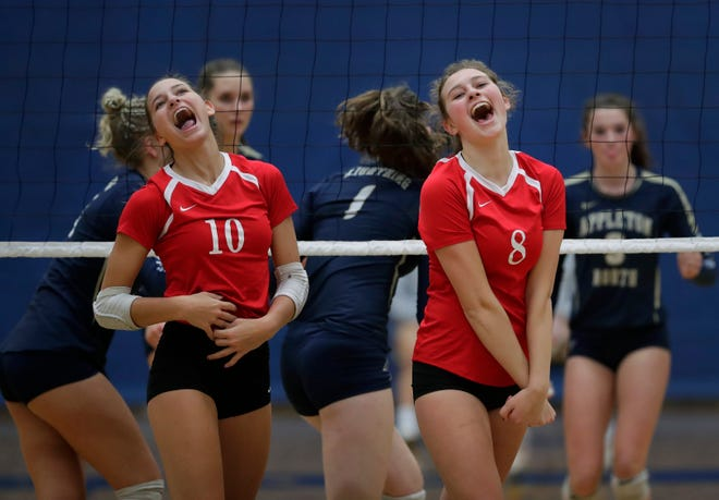Kimberly's Courtney Pearson (10) and Carlee Doering (8) celebrate winning a point against Appleton North during their match Sept. 27 in Appleton. Dan Powers/USA TODAY NETWORK-Wisconsin