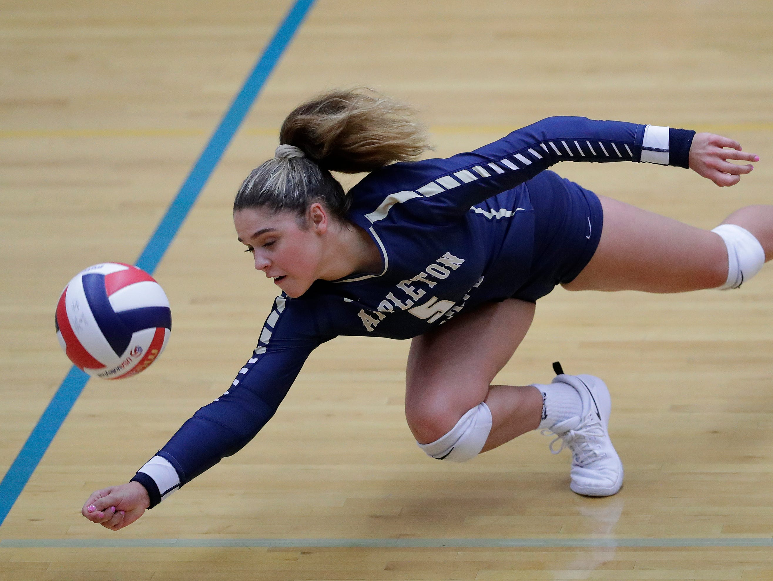Appleton North High School's Niki Van Wyk (5) dives to save a point against Kimberly High School during their girls volleyball match Thursday, Sept. 27, 2018, in Appleton, Wis. 