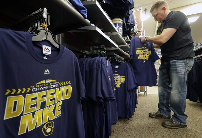 Scheels got its NL Central Division Champions merchandise Wednesday. Here, customer Gary Zarecki of Appleton shops for Brewers post-season attire in the Fox River Mall store.
