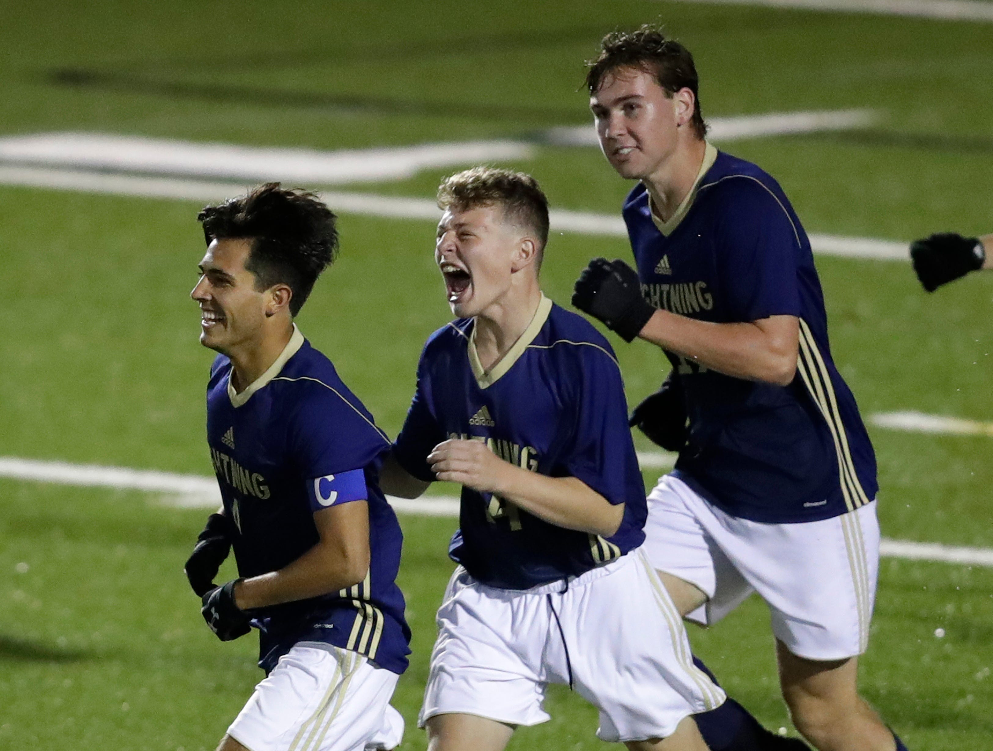 Appleton North High School's Zach Schaefer, left, celebrates scoring a goal with teammates Aiden Greer and Liam Kordyban, right, against Kimberly High School during their boys soccer game Tuesday, Sept. 25, 2018, in Appleton, Wis. Dan Powers/USA TODAY NETWORK-Wisconsin