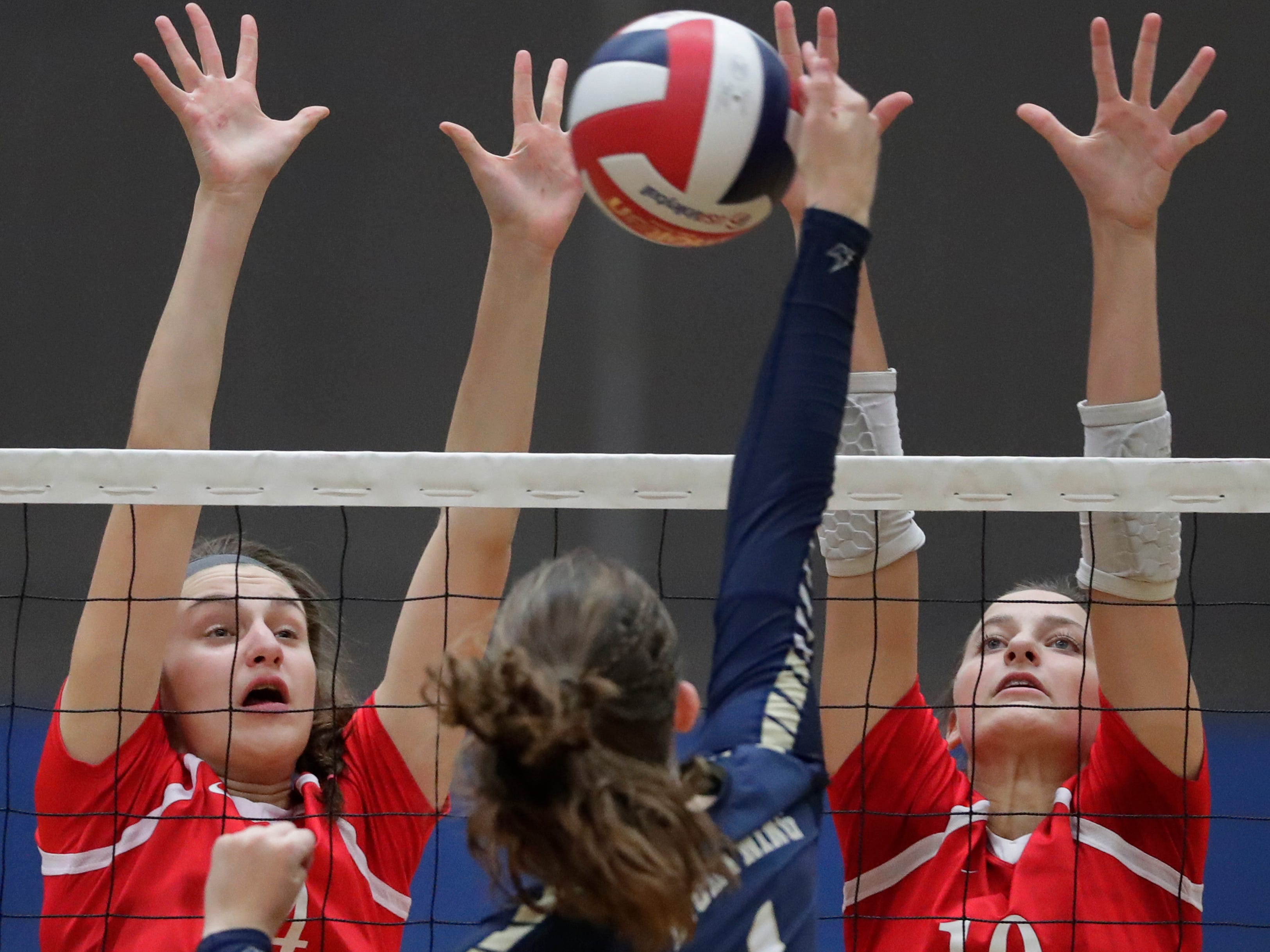Appleton North High School's Sarah Ganser (1) hits a shot against Kimberly High School's Maddy Schreiber (14) and Courtney Pearson (10) during their girls volleyball match Thursday, Sept. 27, 2018, in Appleton, Wis. 