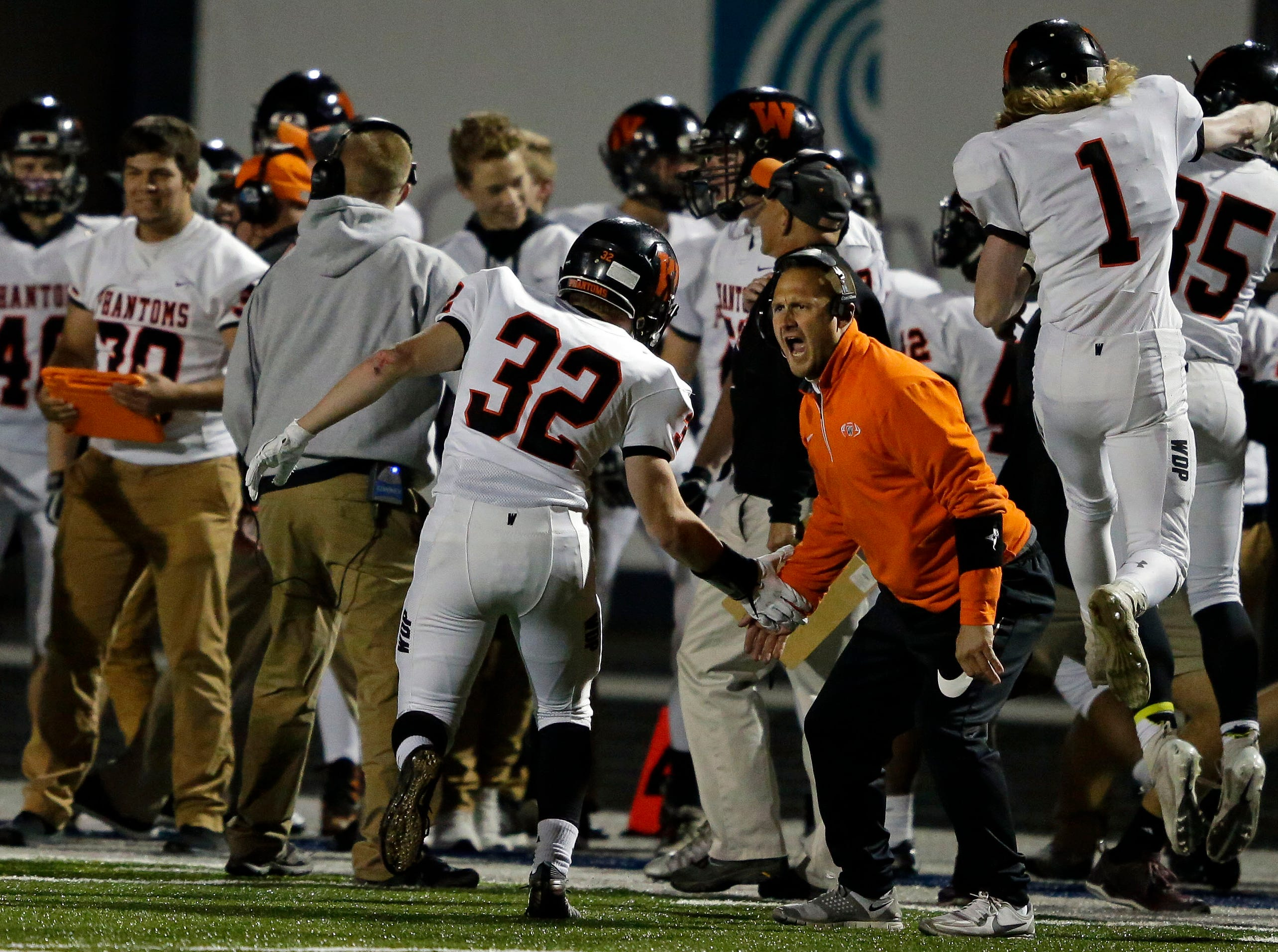 West De Pere players and coaches celebrate a fumble recovery against Menasha in a Bay Conference football game Friday, September 28, 2018, at Calder Stadium in Menasha, Wis.Ron Page/USA TODAY NETWORK-Wisconsin
