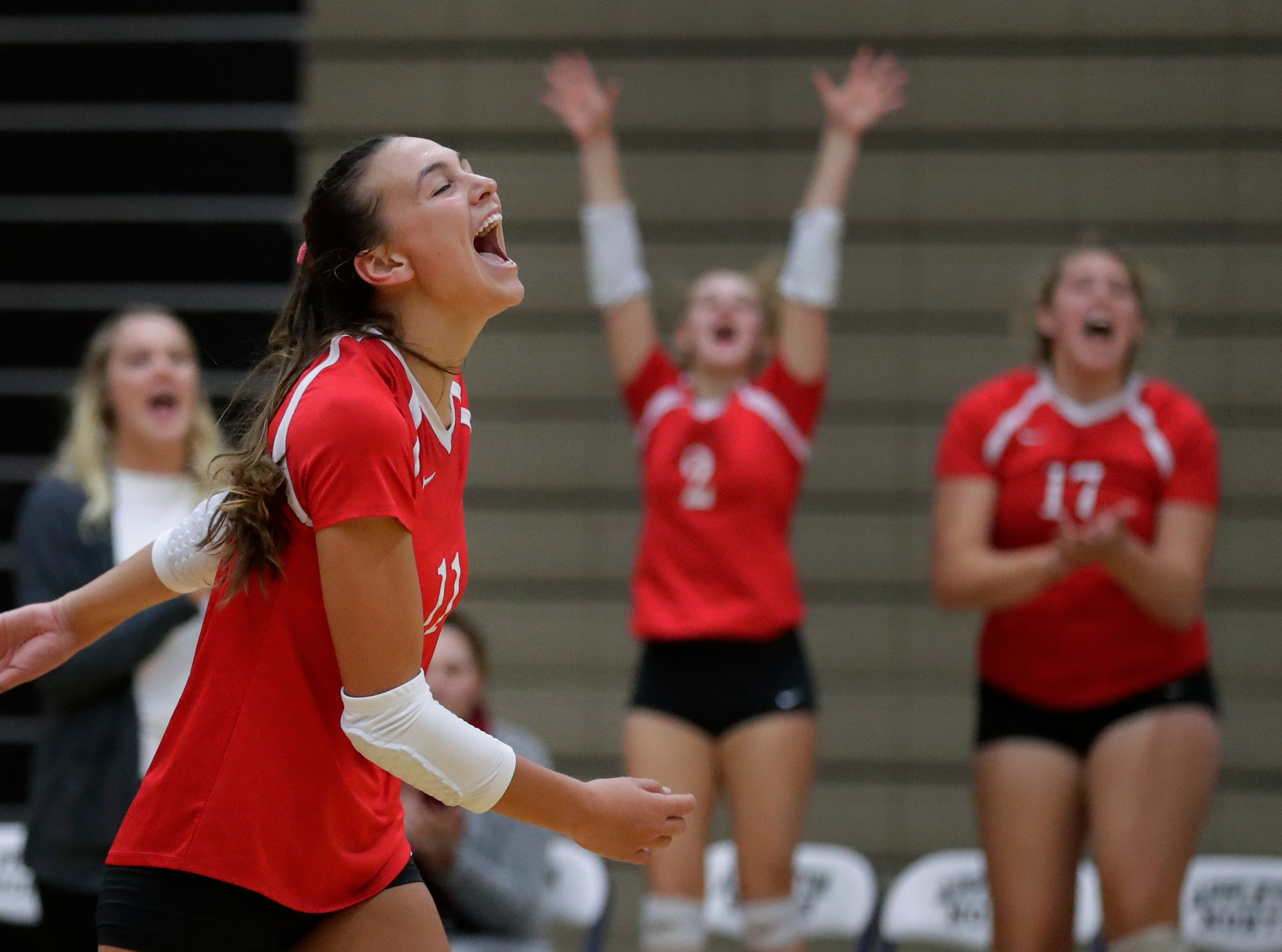 Kimberly High School's Maggie Cartwright (11) celebrates winning a point against Appleton North High School during their girls volleyball match Thursday, Sept. 27, 2018, in Appleton, Wis. 