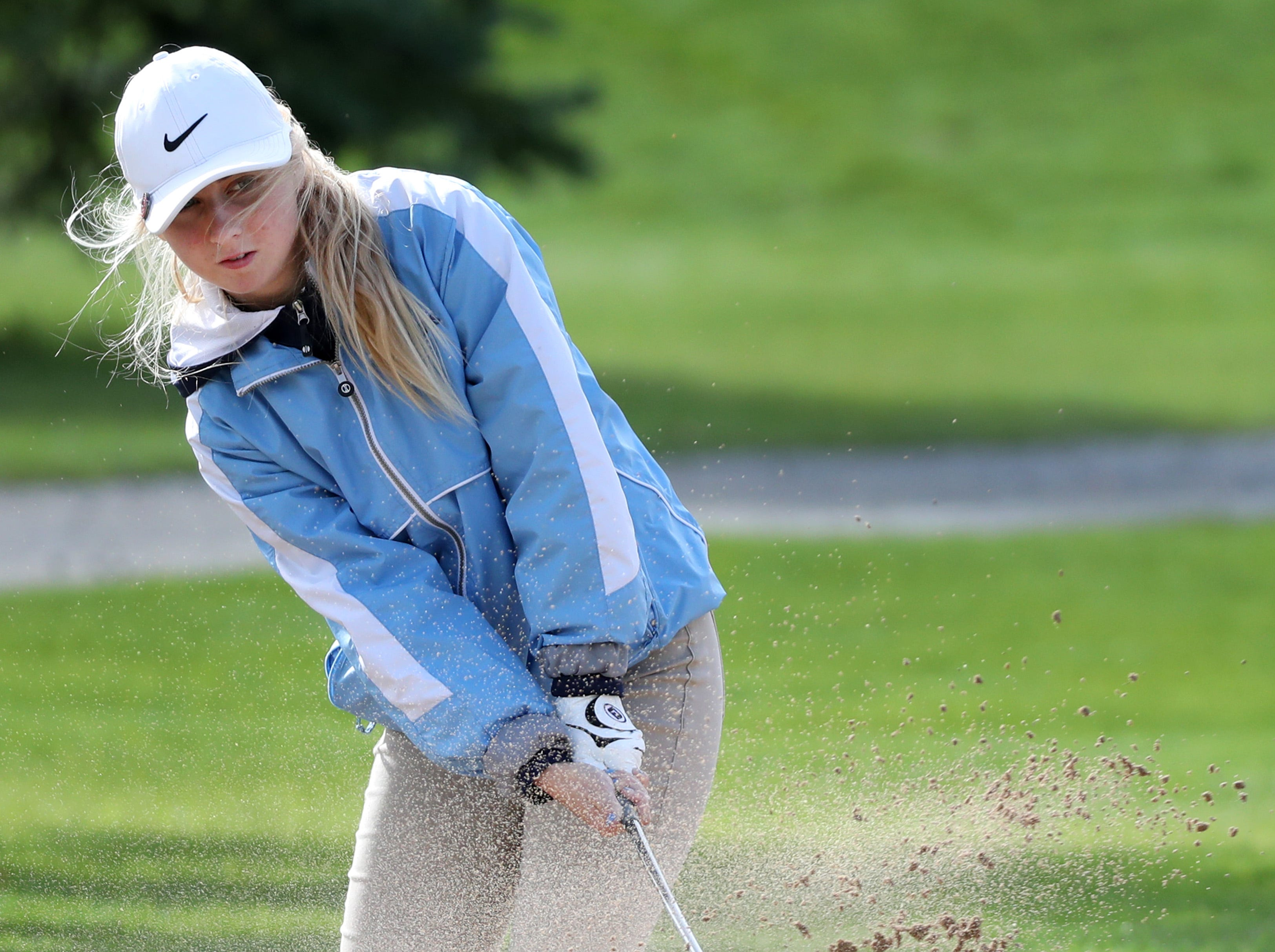 Little Chute's Sophie Brown hits out of a sandtrap during the WIAA Division 2 Regional Girls Golf Tournament Wednesday, Sept. 26, 2018, at Mid Vallee Golf Course in De Pere, Wis.Danny Damiani/USA TODAY NETWORK-Wisconsin