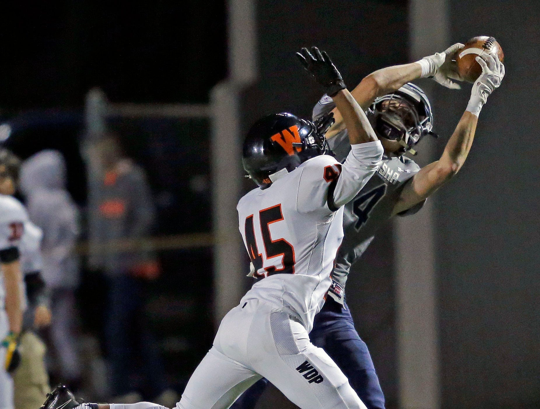 Isiah Burdette of West De Pere plays defense against Ben Romnek of Menasha in a Bay Conference football game Friday, September 28, 2018, at Calder Stadium in Menasha, Wis.Ron Page/USA TODAY NETWORK-Wisconsin