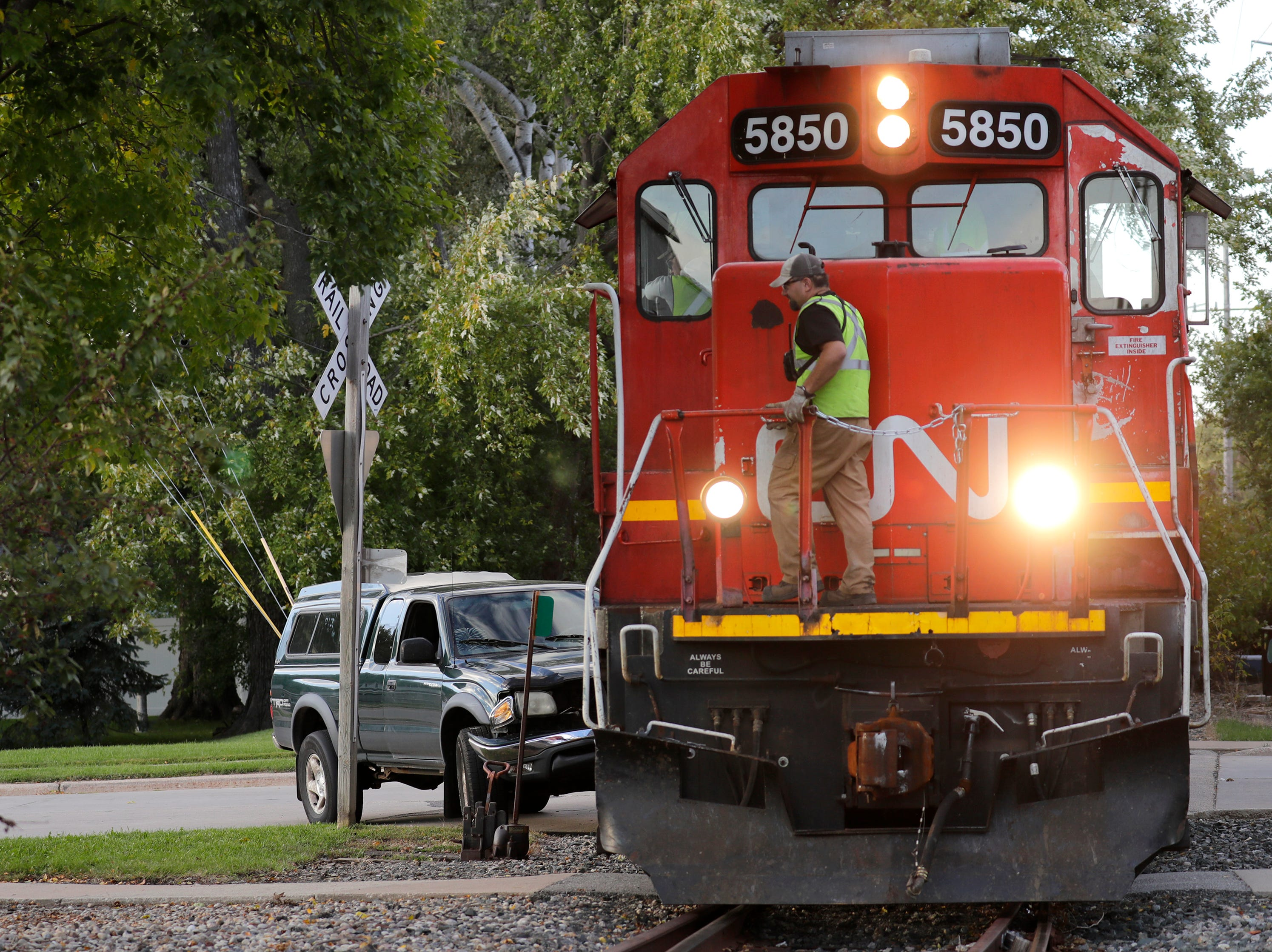 A Canadian National employee investigates the scene of a  truck versus train crash Wednesday, Sept. 26, 2018, Fire Station 40 in Fox Crossing, Wis. Dan Powers/USA TODAY NETWORK-Wisconsin