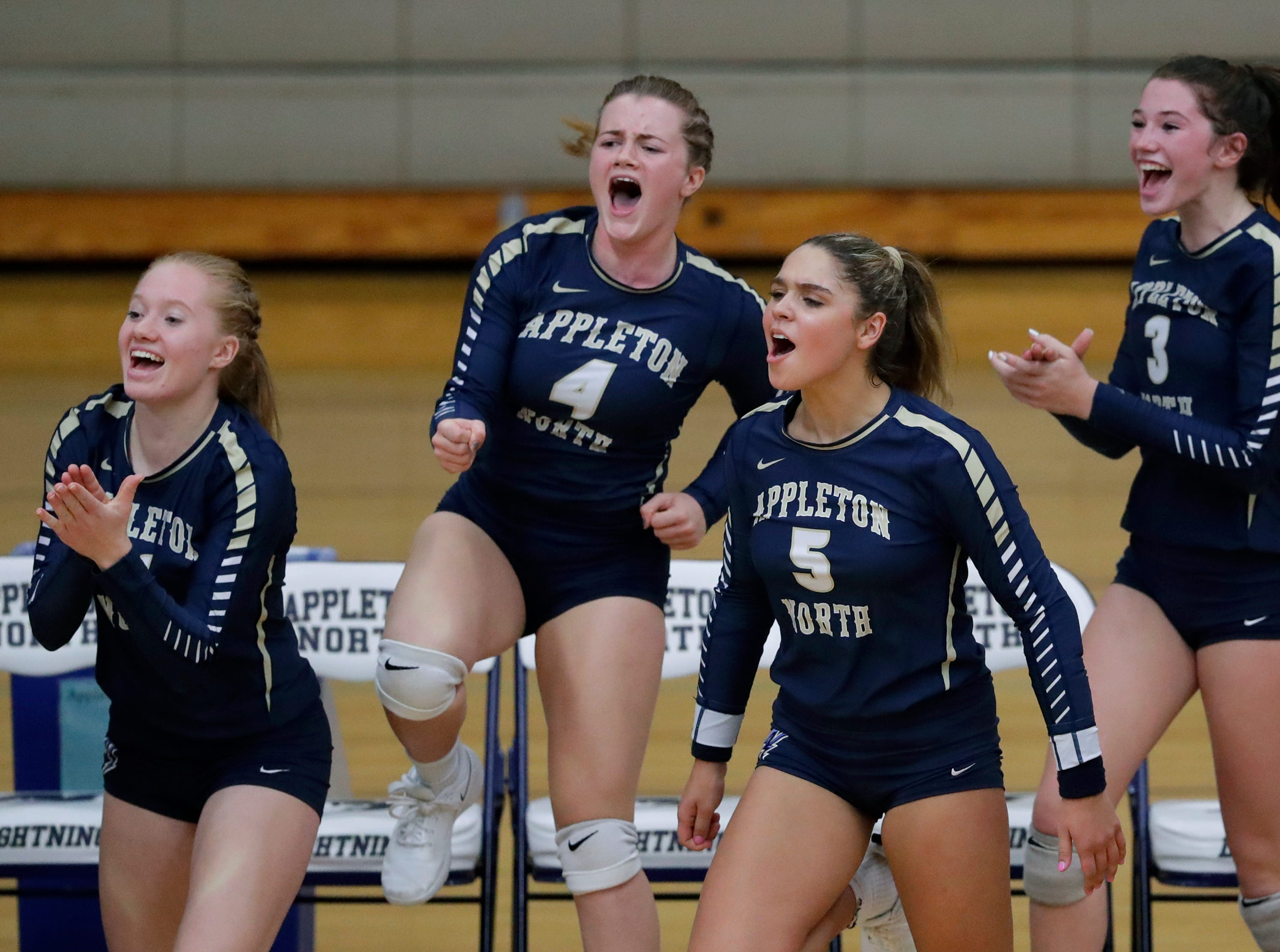 Appleton North High School's players celebrate winning a point against Kimberly High School during their girls volleyball match Thursday, Sept. 27, 2018, in Appleton, Wis. 