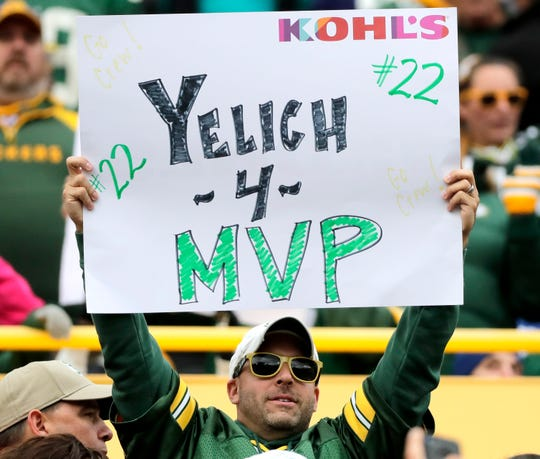 A Packers fan at the game against the Bills earlier this month shows he's also behind the Brewers.