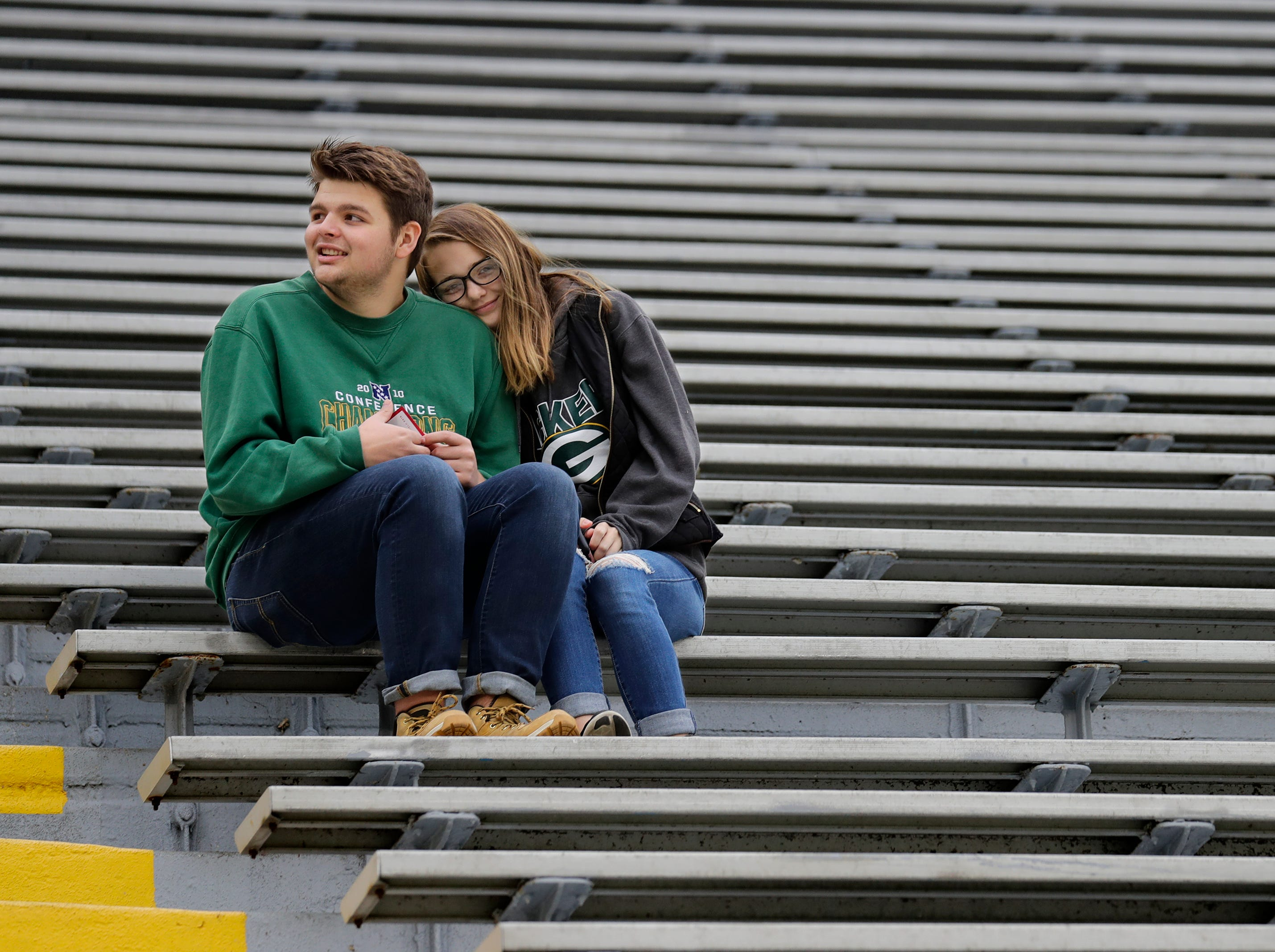Bryan Osterberg, left, and Christine Neuville, both of De Pere, huddle up to stay warm as they get to their seats early for the Green Bay Packers game against the Buffalo Bills Sunday, Sept. 30, 2018, at Lambeau Field in Green Bay, Wis. Dan Powers/USA TODAY NETWORK-Wisconsin