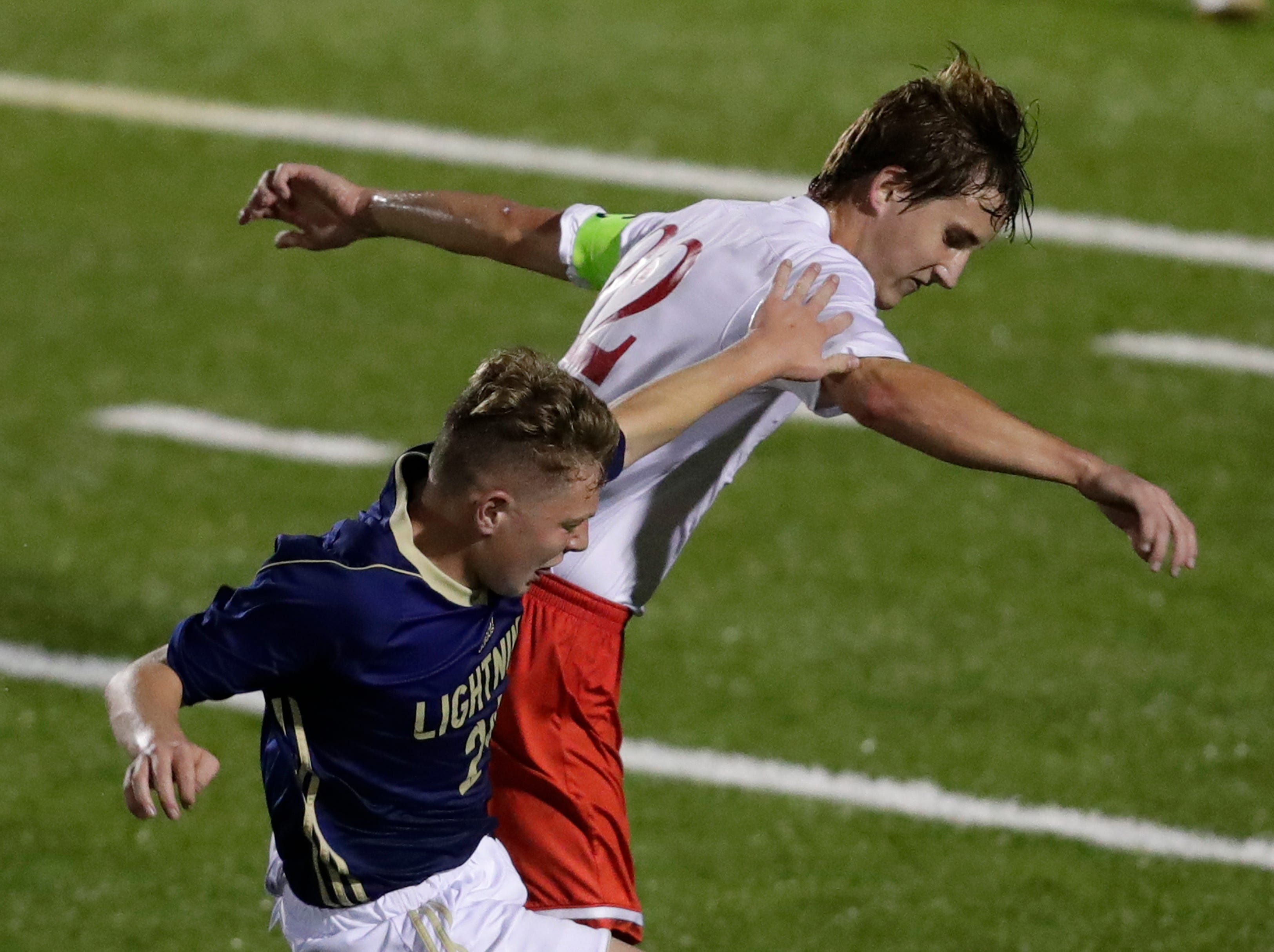 Appleton North High School's Aiden Greer, left, defends against Kimberly High School's Jon Carl during their boys soccer game Tuesday, Sept. 25, 2018, in Appleton, Wis. Dan Powers/USA TODAY NETWORK-Wisconsin