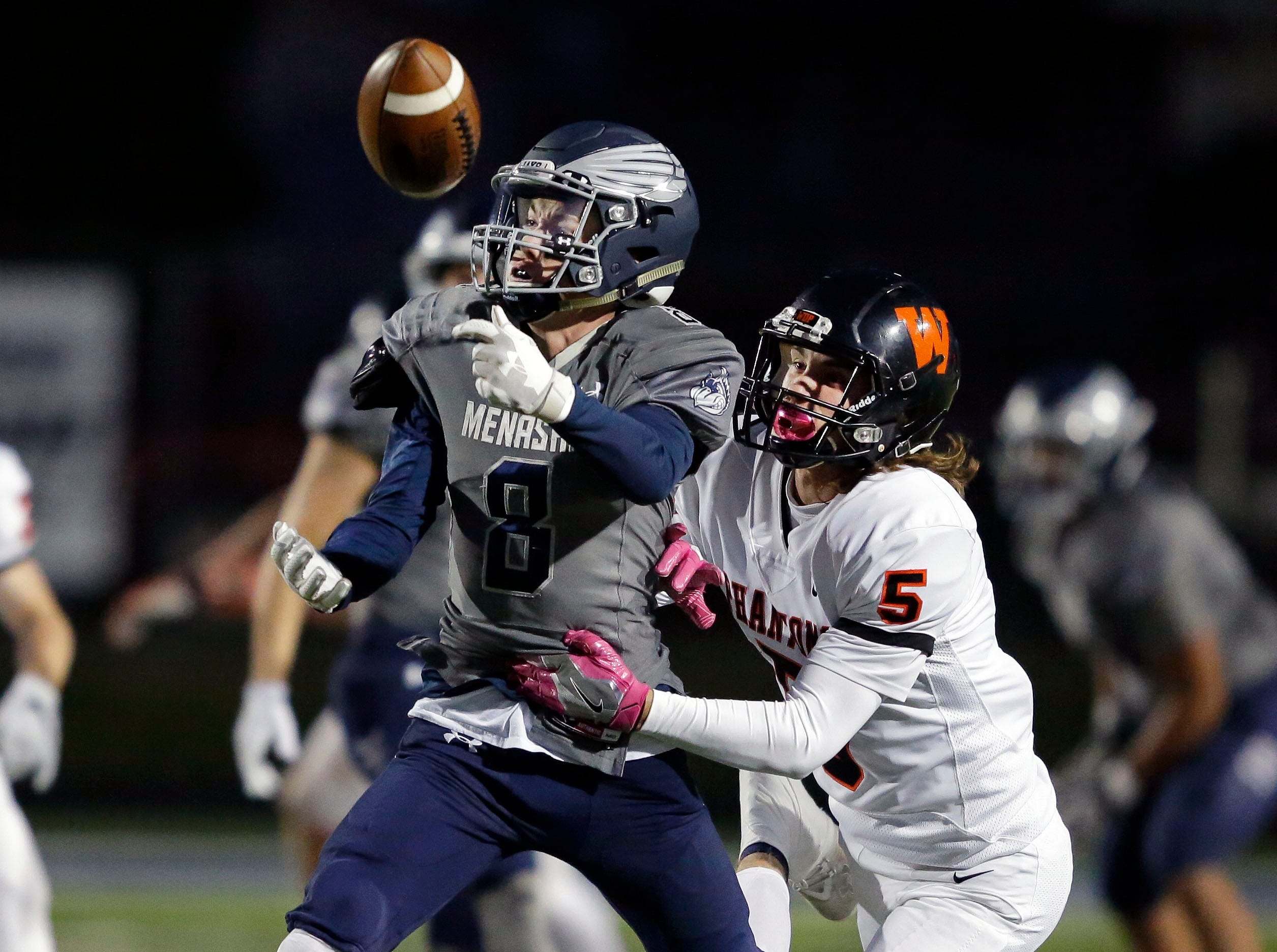 A pass is just out of reach for Brady Jurgella of Menasha as he is defended by Garrett Kempen of West De Pere in a Bay Conference football game Friday, September 28, 2018, at Calder Stadium in Menasha, Wis.