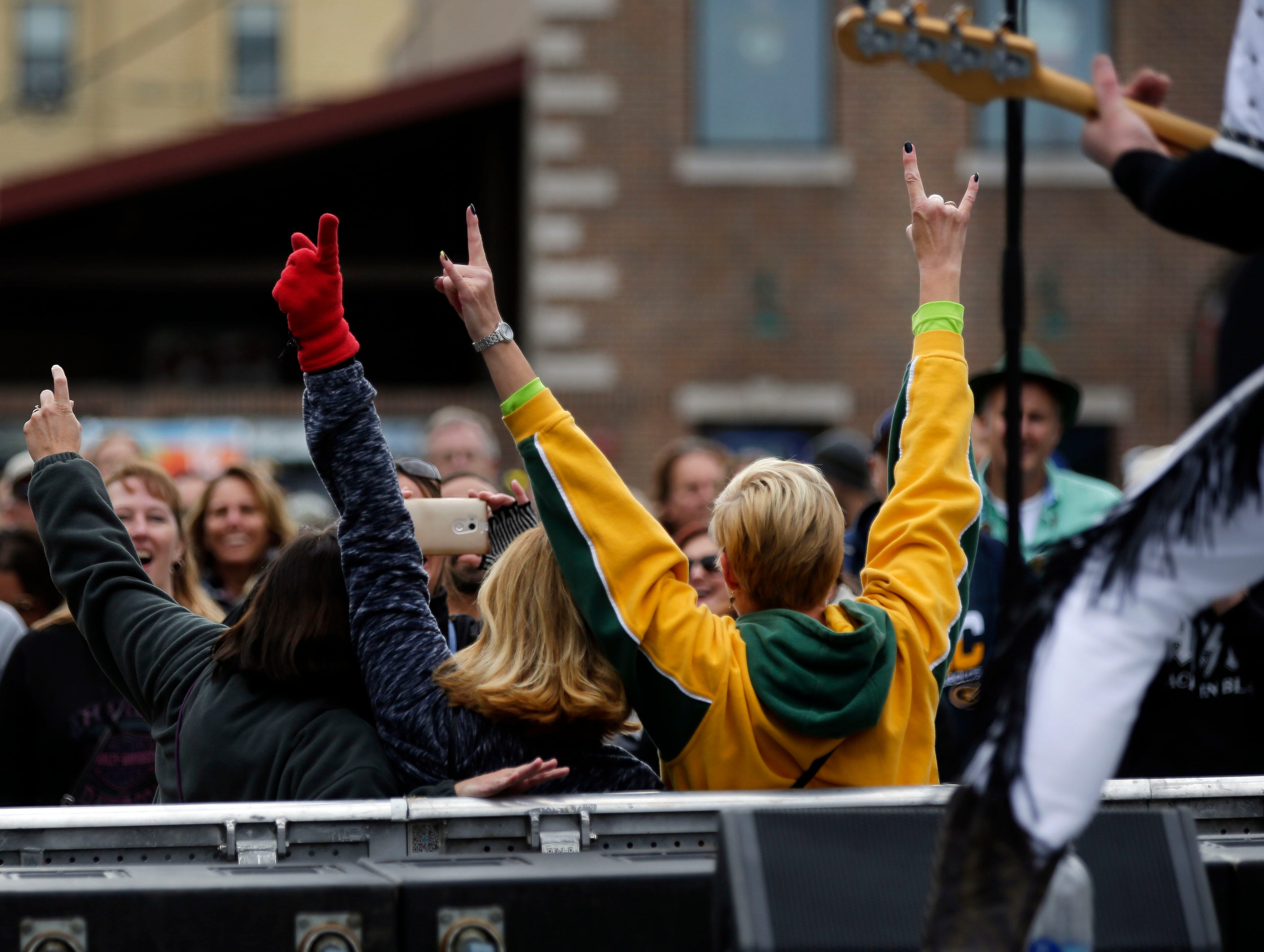 Time for photos with the musicians as The Glam Band performs during Octoberfest 2018 Saturday, September 29, 2018, in downtown Appleton, Wis.Ron Page/USA TODAY NETWORK-Wisconsin