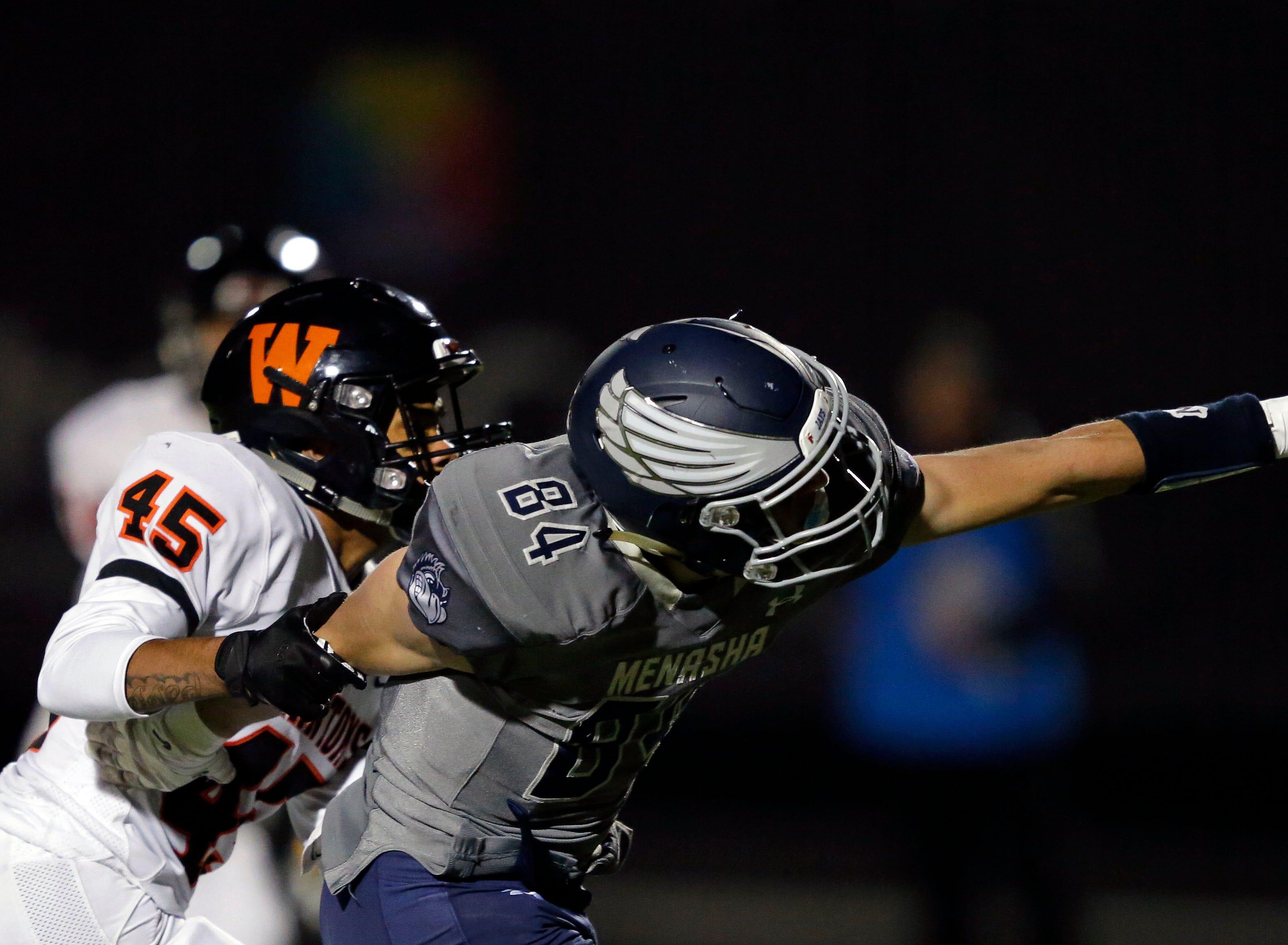 Isiah Burdette of West De Pere is called for pass interference against Ben Romnek of Menasha in a Bay Conference football game Friday, September 28, 2018, at Calder Stadium in Menasha, Wis.Ron Page/USA TODAY NETWORK-Wisconsin