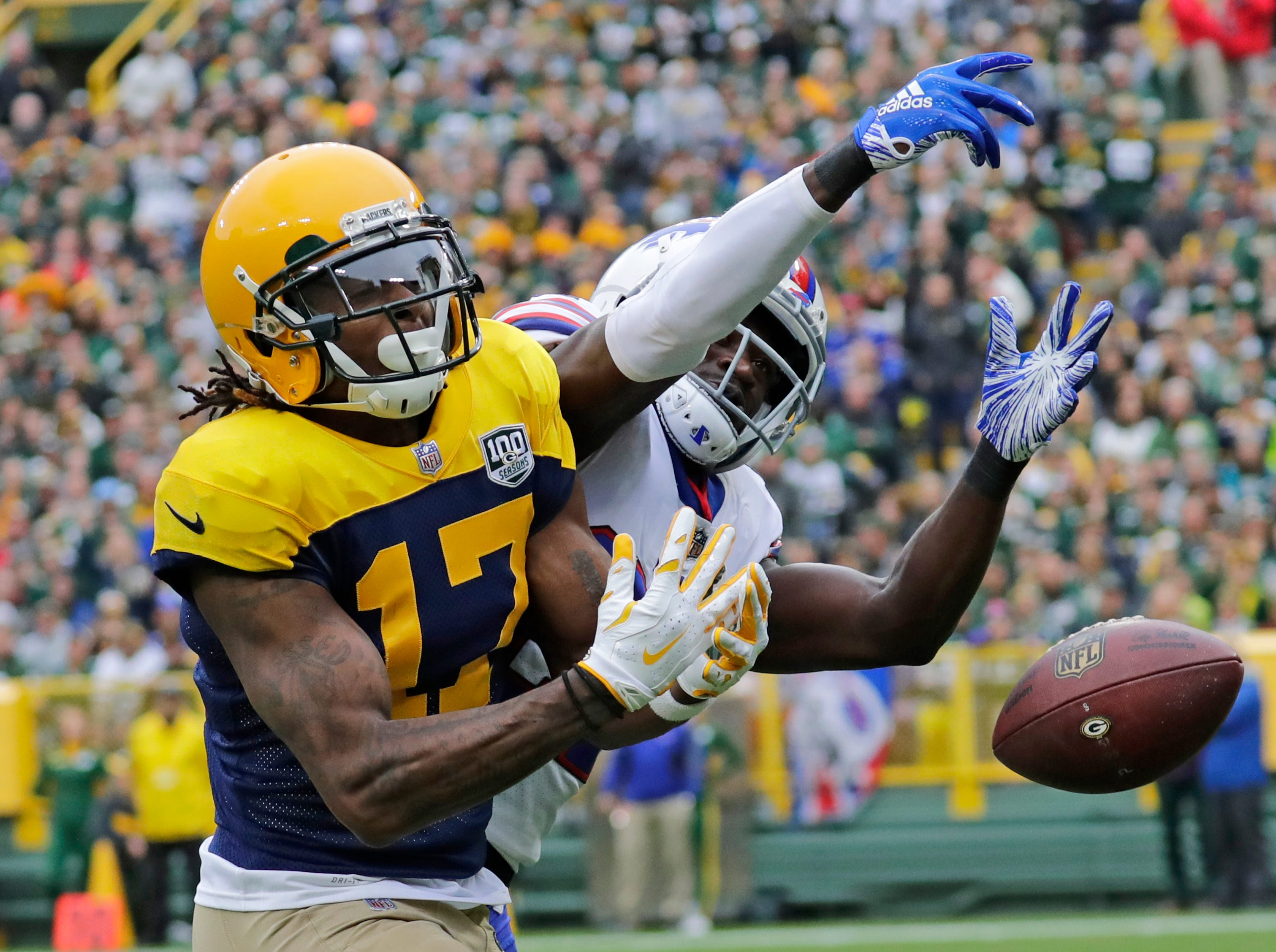 Green Bay Packers wide receiver Davante Adams (17) drops a pass in the end zone against Buffalo Bills cornerback Tre'Davious White (27) in the first half during their football game Sunday, Sept. 30, 2018, at Lambeau Field in Green Bay, Wis. 