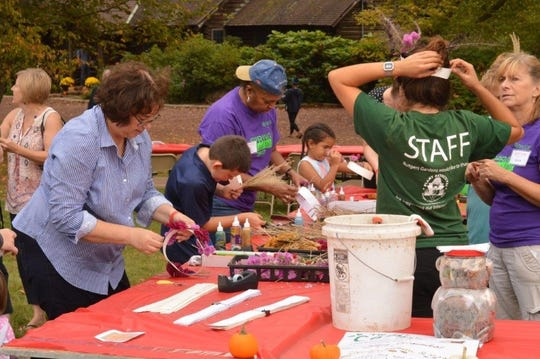 Kids and adults make crowns with dried flowers at the 2017 Rutgers Gardens Fall Festival.