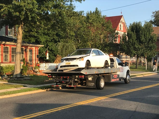 Two cars collided, blocking off a section of County Road 539 - also called North Green Street - early Thursday.