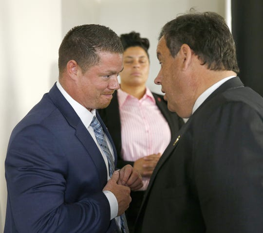 "Recovery specialist John Brogan, Toms River, speaks with Governor Chris Christie during a break in the ""Solutions for a New Way Forward"" panel discussion at Jersey Shore University Medical Center in Neptune, Thursday, May 19, 2016."