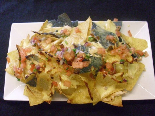 Chicken nachos are a top seller at Jamian's Food and Drink in Red Bank.