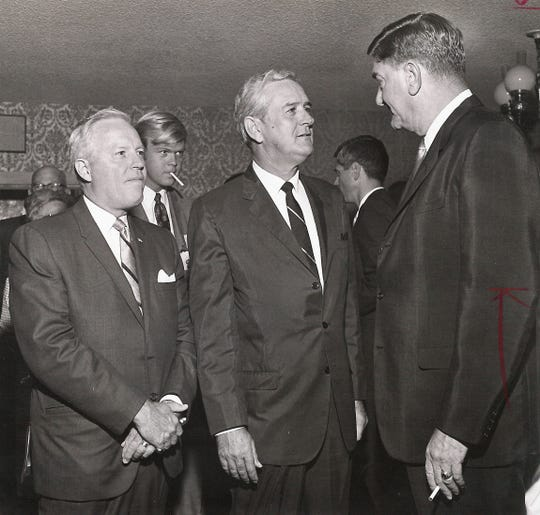 From left, Abilene attorney Tom Gordon and Gov. John Connally talk with Abilene Mayor Ralph Hooks at a dinner July 29, 1968, at the Golden Stagecoach Restaurant at Old Abilene Town.