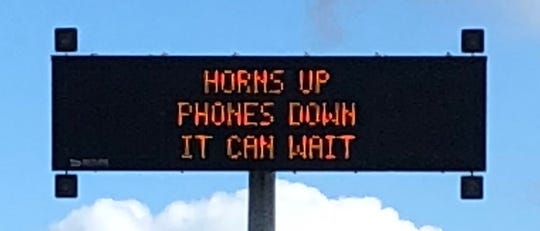 No-texting signs on highways leading to State Fair of Texas refer to the UT-OU Red River Rivalry game. The signs were shared by TxDOT Executive Director James Bass on Thursday.