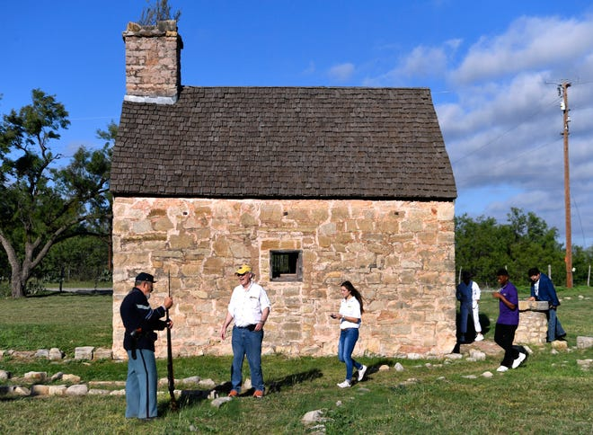Timothy Phillips, a living historian, answers questions at Fort Phantom Hill Thursday. About a dozen cars set out from Frontier Texas! to recreate the original Texas Forts Trail caravan taken by Gov. John Connally 50 years ago.