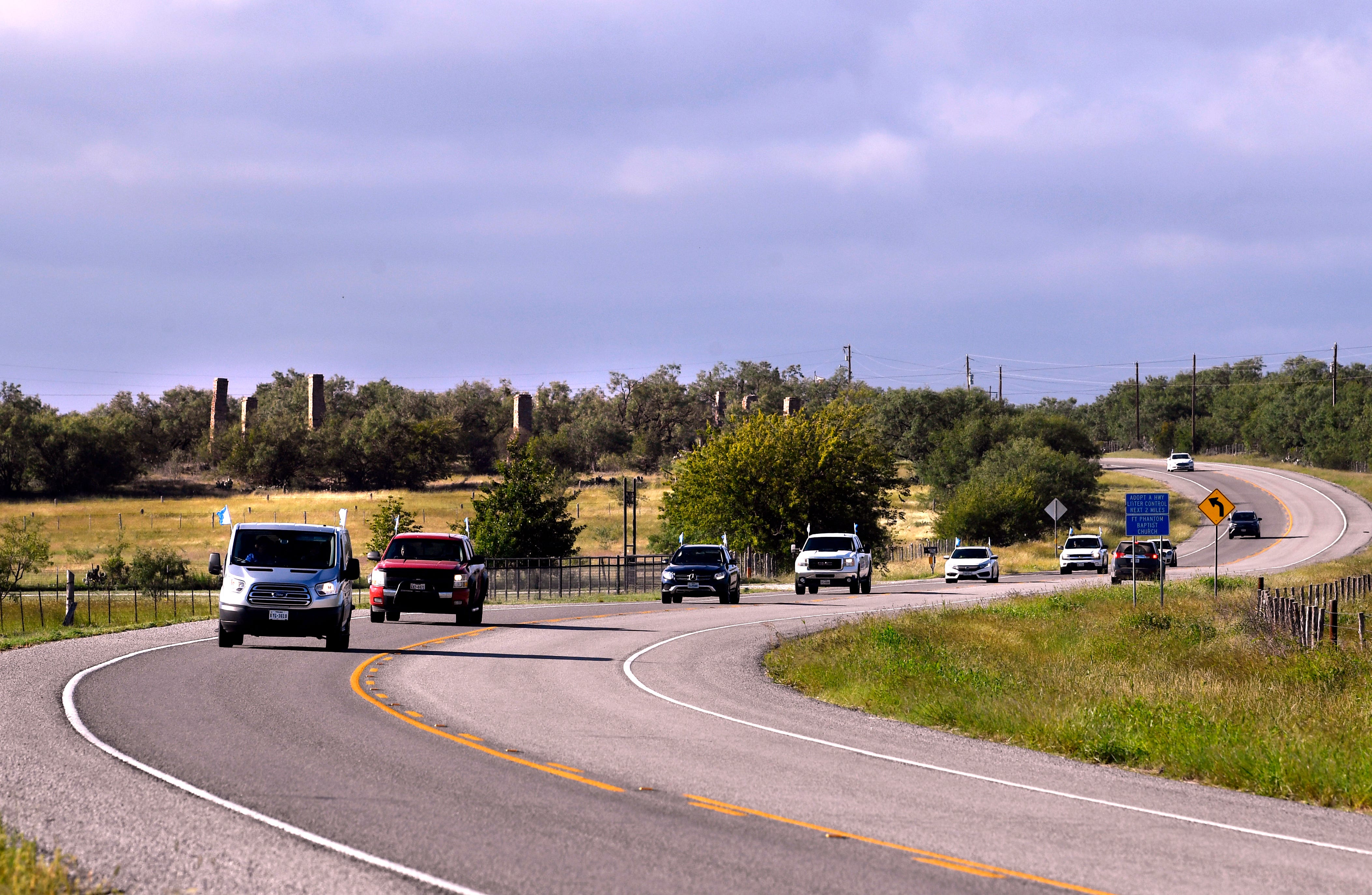 With Fort Phantom Hill in the background, a caravan of vehicles drives along FM 600 Thursday to their next destination, Fort Griffin.