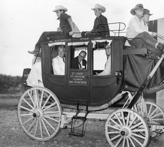 From left, Gov. John Connally, State Rep. Grant Jones, and Texas Historical Survey Committee director Truett Latimer sit in a stagecoach at Fort Griffin on July 29, 1968, during a tour of the Texas Forts Trail.