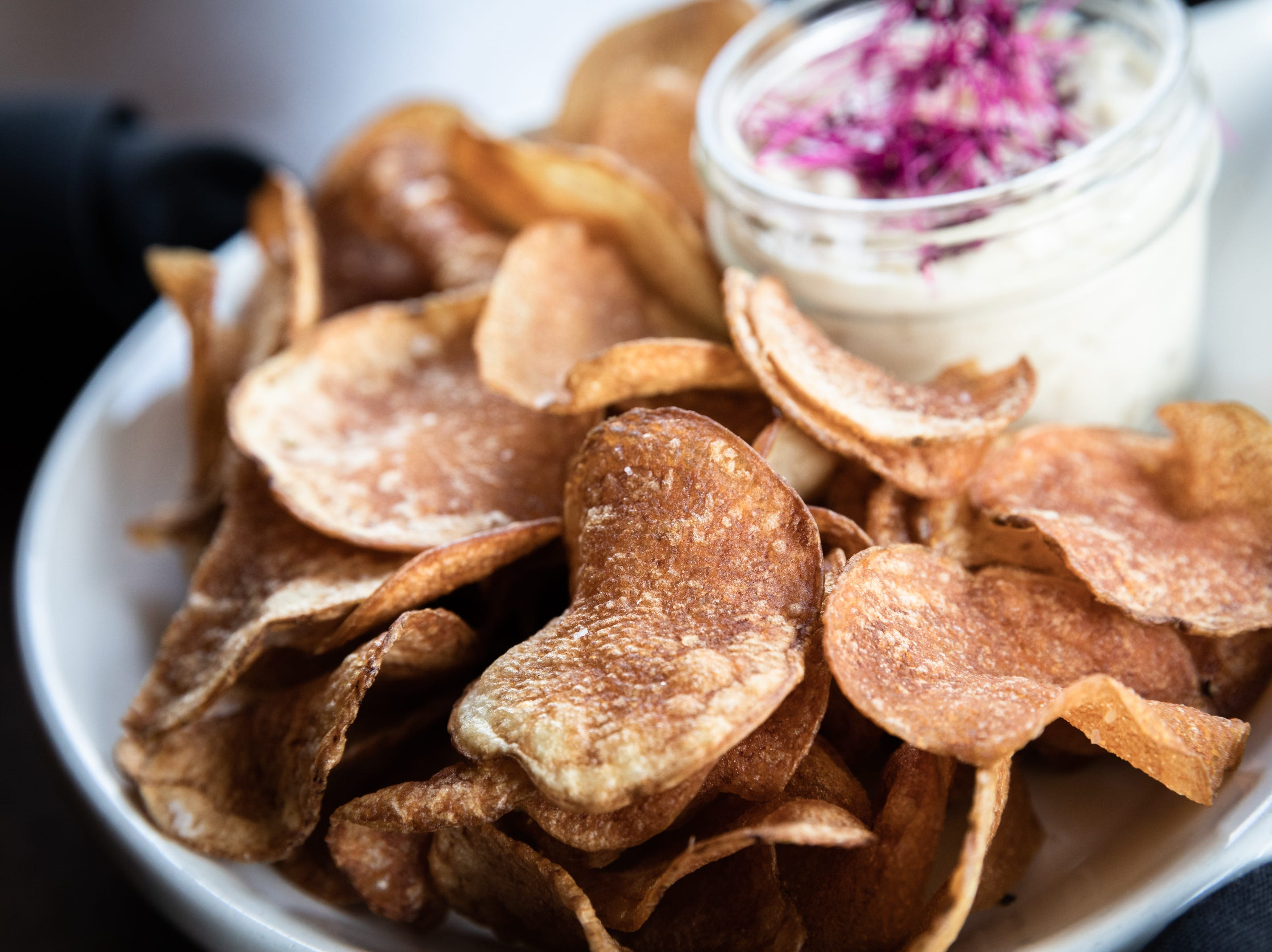 Bourbon caramelized onion dip with potato chips offered at Bone and Broth restaurant on Charlotte Street.