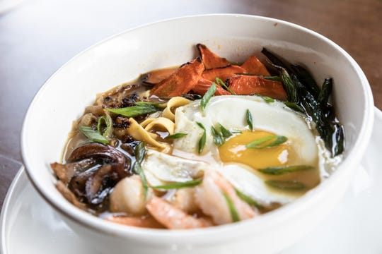 Bone Broth bowl with noodles, carrots, green beans, mushrooms, caramelized onions and a sunny egg, offered at Bone and Broth restaurant on Charlotte Street.