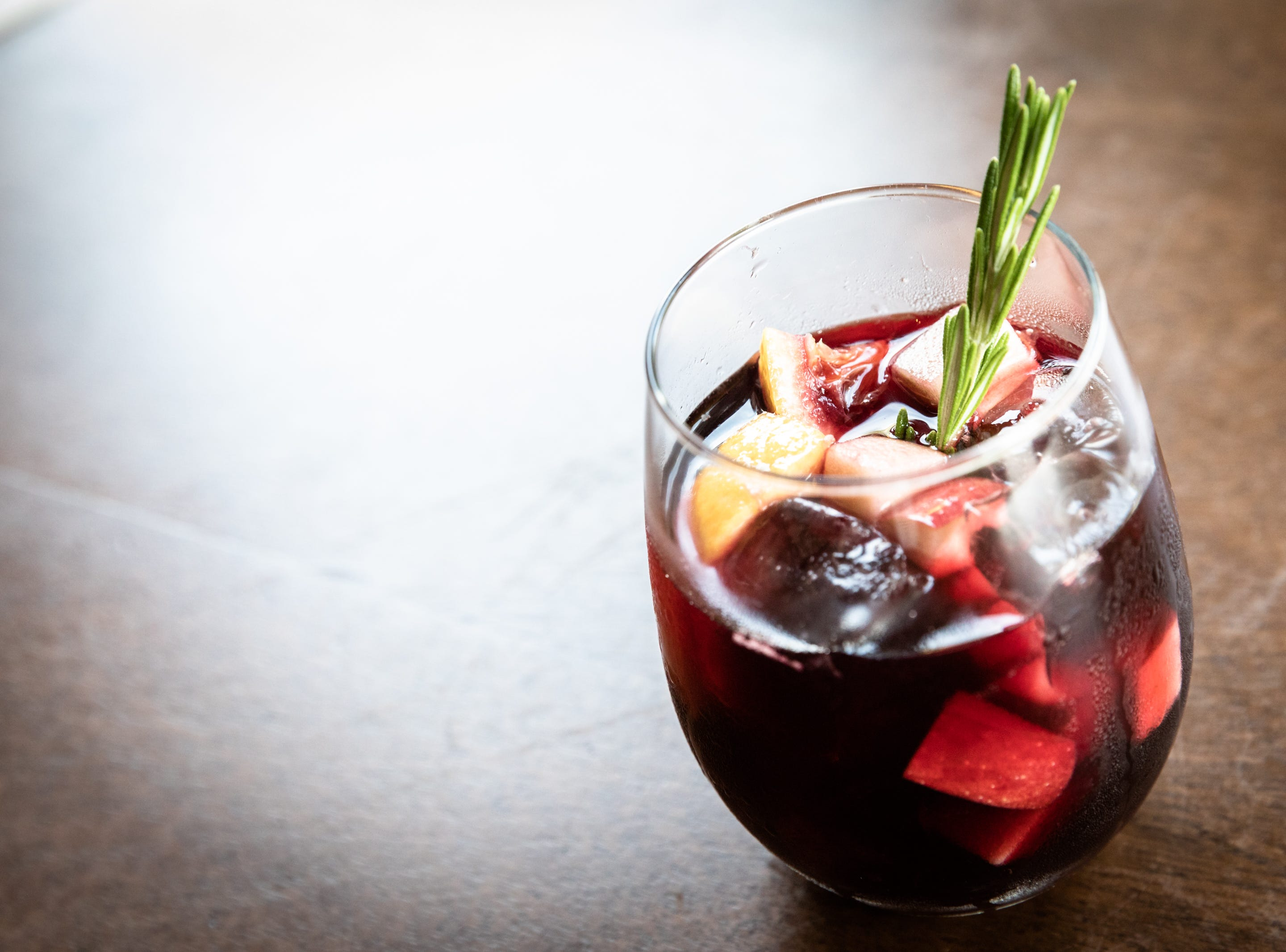 The Winter Sangria with red wine, Goldschlager, orange and apple, offered at Bone and Broth restaurant on Charlotte Street.