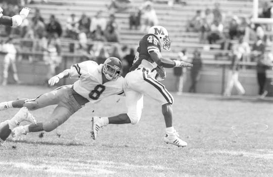 Western Michigan defensive back Willie Berris (8) goes for a tackle against Miami (Ohio) in 1988.