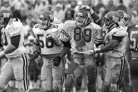 Western Michigan's Joel Smeenge (89) and Terry Crews (94) celebrate a play against Ball State in 1988.