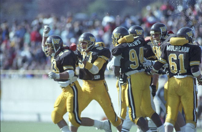 The Western Michigan defense celebrates coming off the field against Central Michigan during their 1988 contest.