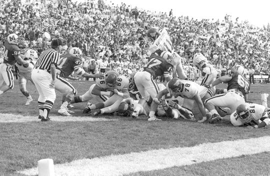 Western Michigan quarterback Tony Kimbrough goes over the top for a touchdown against Miami (Ohio) in 1988.