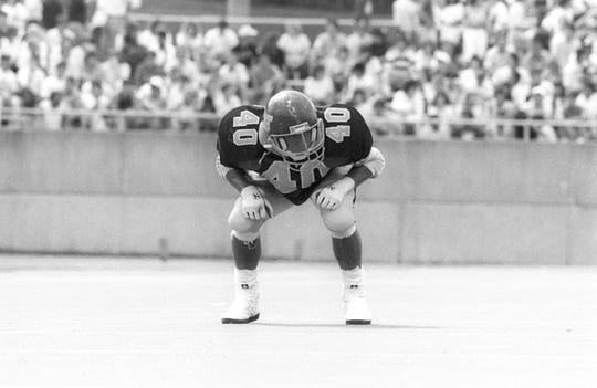 Western Michigan linebacker Paul DeVries gets set in a 1988 game against Indiana State.