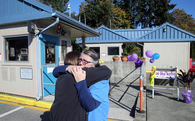 Deborah Harrah of Bremerton the mother of former Washington State Ferries employee Katie Phillips gets a hug from her daughter's co-worker Linda Lindsley at the Southworth Ferry Terminal Thursday, October 4, 2018. Phillips passed away at a tragic accident on Highway 160 near Long Lake in Port Orchard. Southworth ferry workers and friends held a small memorial for Phillips outside the toll booths.