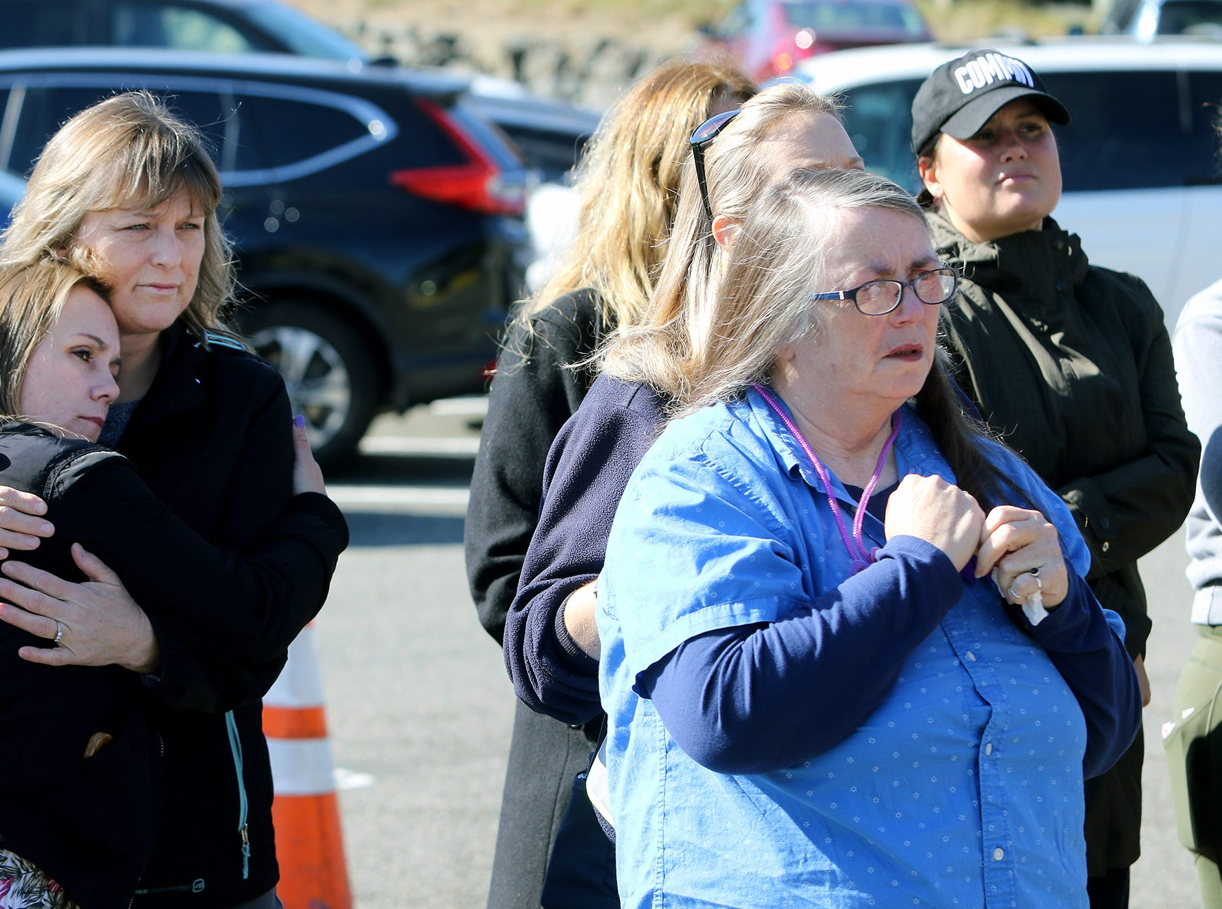 Deborah Harrah of Bremerton the mother of former Washington State Ferries employee Katie Phillips listens from co-workers of her daughter's during a small memorial at the Southworth Ferry Terminal Thursday, October 4, 2018. Phillips passed away at a tragic accident on Highway 160 near Long Lake in Port Orchard.