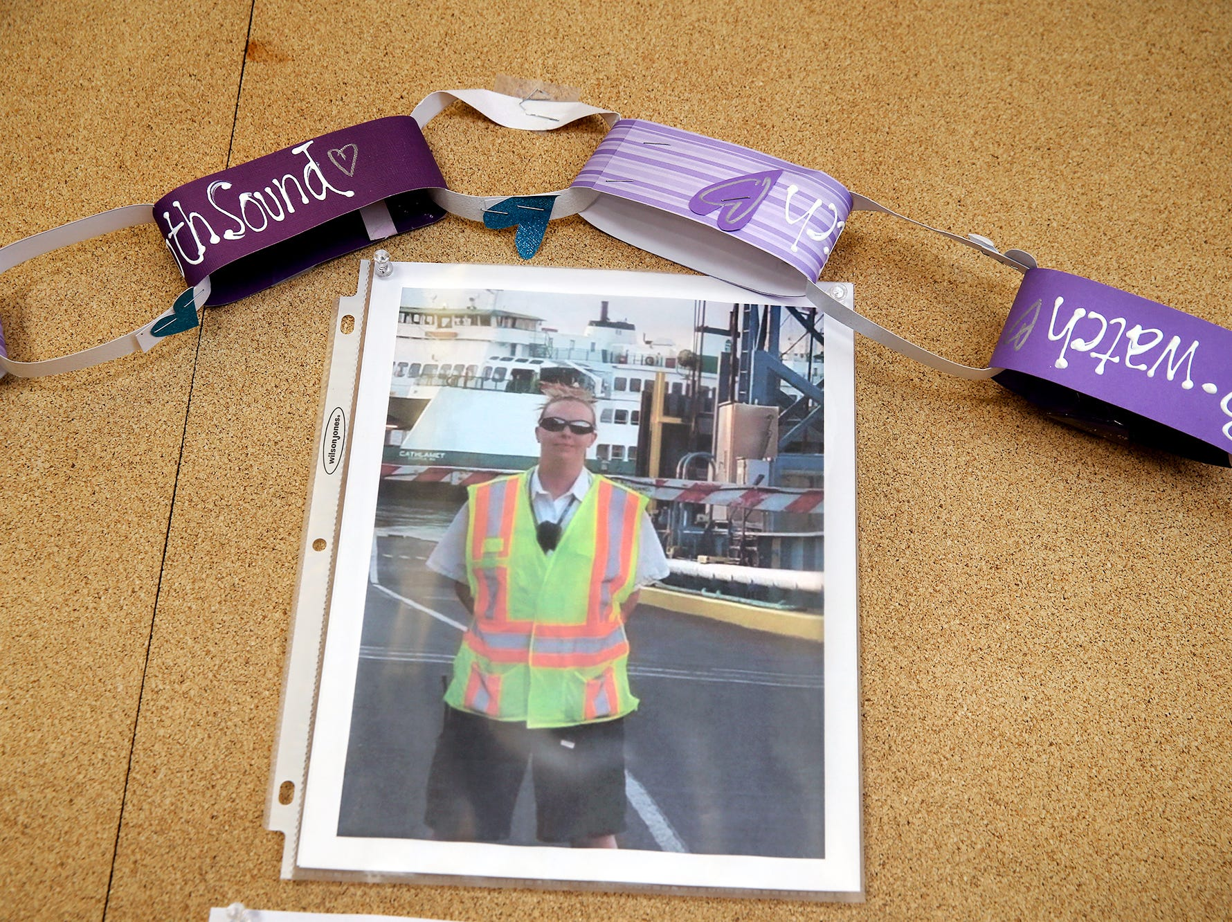 A photo is inside the Southworth passenger terminal for former Washington State Ferries employee Katie Phillips on Thursday, October 4, 2018. Phillips passed away at a tragic accident on Highway 160 near Long Lake in Port Orchard.