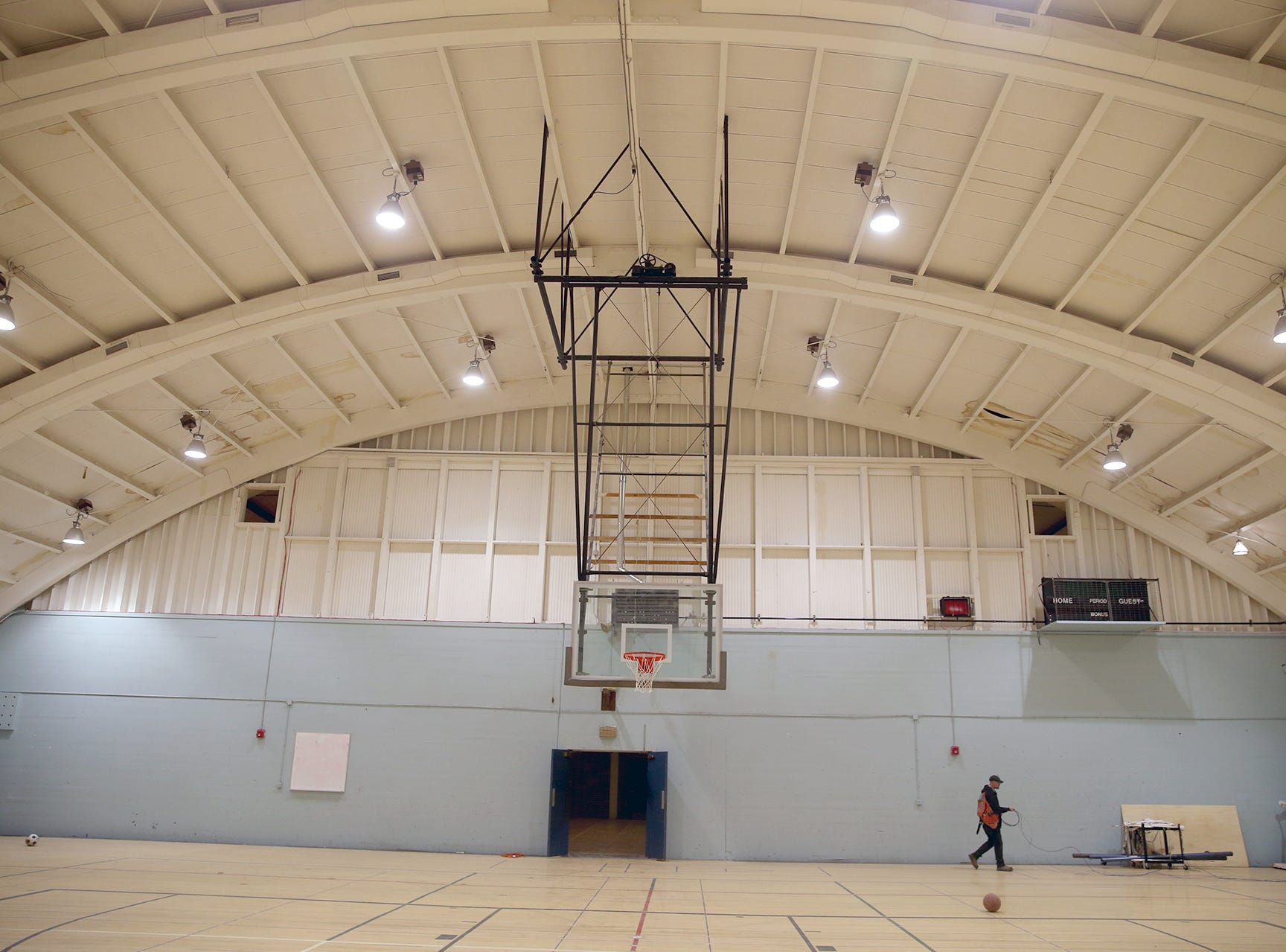The old curved roof with new lighting inside the old East High basketball court  in the  the old gymnasium,.