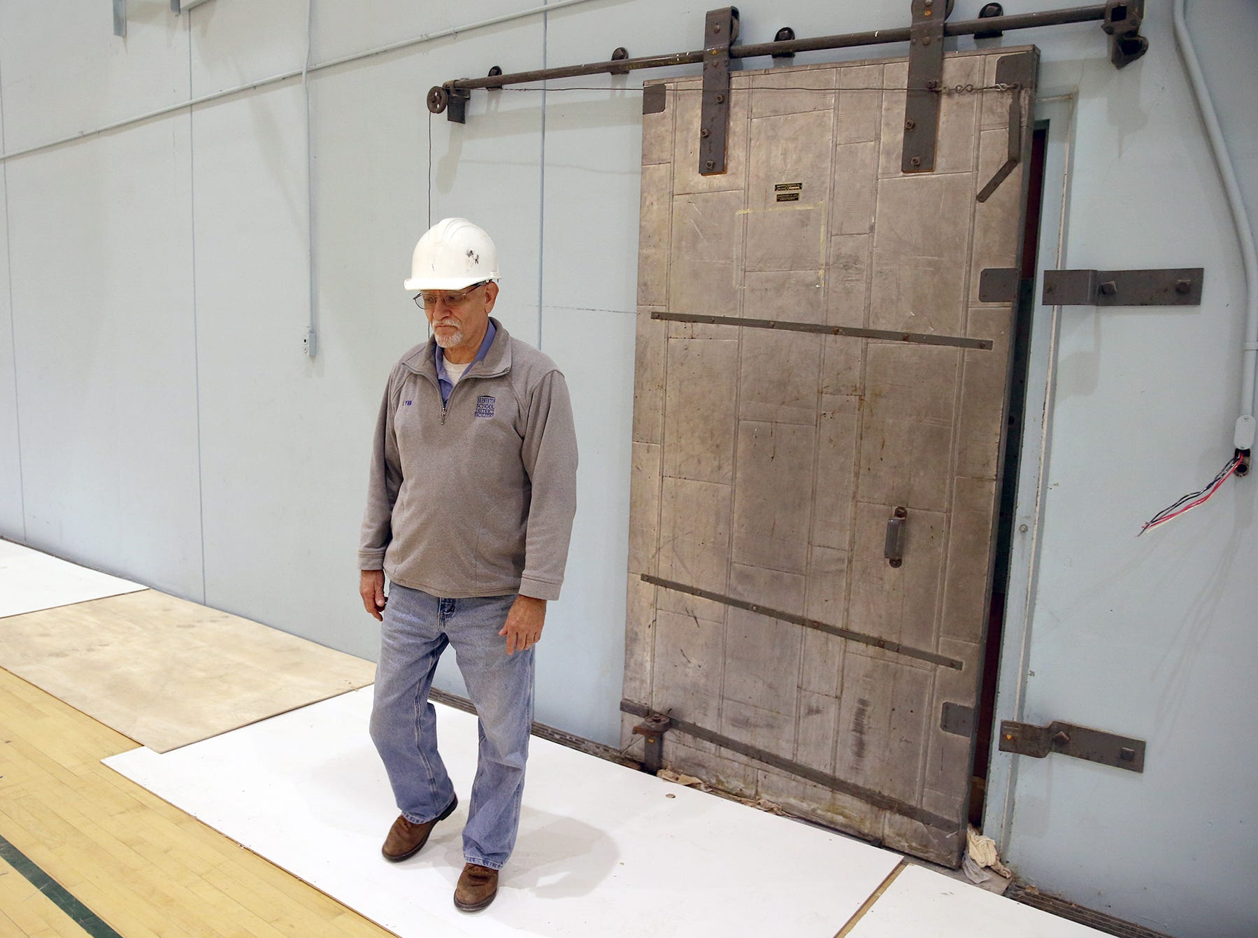 All that remains of the old East High, and Bremerton junior High School is the classic gymnasium. Lynn Cleary maintenance foreman of the Bremerton School District by an old steel door which used to lead to the boys locker room in the  the old gymnasium,.