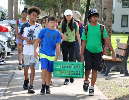 "Members of the Eagle Team, gifted students from Central Middle School, arrive. ""A Day in the Life of the Indian River Lagoon"", managed by S.E.A. a Difference Environmental Services. Experts from Florida Tech teamed up with 7th grade students and teachers from Central Middle School in West Melbourne to research the water near Ryckman Park in Melbourne Beach. An estimated 1,800 students participated from Volusia to Palm Beach counties in this effort."