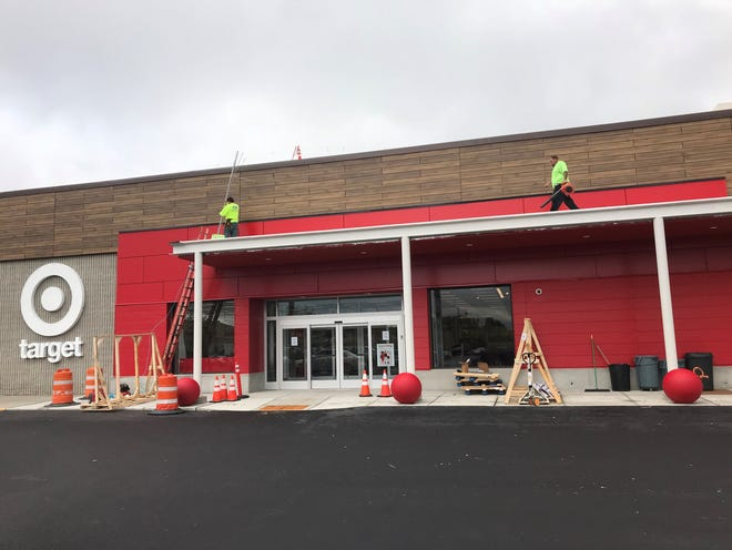 Workers finish up the main entrance to the new Target in South Burlington on Wednesday, Oct. 3, 2018.