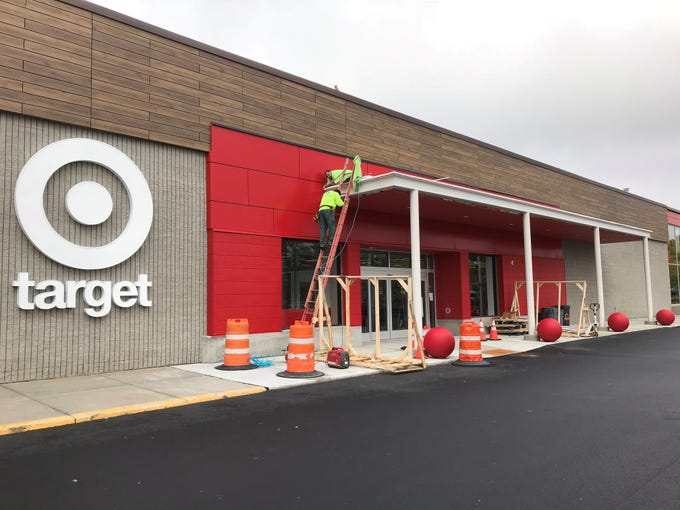 Workers put the finishing touches on the main entrance to Target in South Burlington on Oct. 3, 2018.