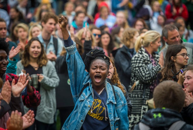 University of Vermont student Ama Sika joins hundreds of other students and faculty to protest Supreme Court nominee Brett Kavanaugh on Thursday, Oct. 4, 2018, in support of Christine Blasey Ford, who has accused him of sexual assault when the two were teenagers.