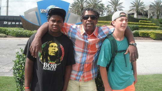 Bobby Hackney and his son, Jehric Hackney, and Harrison Leombruno-Nicholson pose for a photo at Universal Studios in Florida.