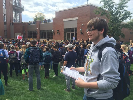 "Brandyn Falkofske, a first-year student at the University of Vermont from Wisconsin, said he only found two students to register to vote. ""Everyone else was registered.""  Falkofske was among the hundreds of students from the University of Vermont and Champlain College gathered for a protest against Supreme Court nominee Brett Kavanaugh on Thursday, Oct. 4, 2018, the UVM Campus in Burlington."