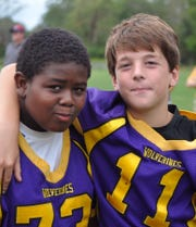 Born on the same day, Jehric Hackney, left, and Harrison Leombruno-Nicholson have been best friends since they joined the Wolverines youth football program as second-graders.