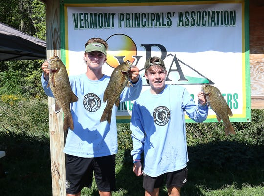 South Burlington's Cam Chiari and Carson Cherry pose with their bass at a competition last month.